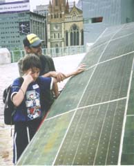 A father explains the solar car to his blind son. A great reason to touch the display