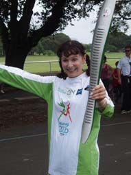 Runner 034 in the Queen's Baton Relay
