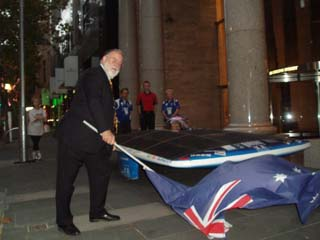 Peter Young flags the solar car away at 6.25 AM